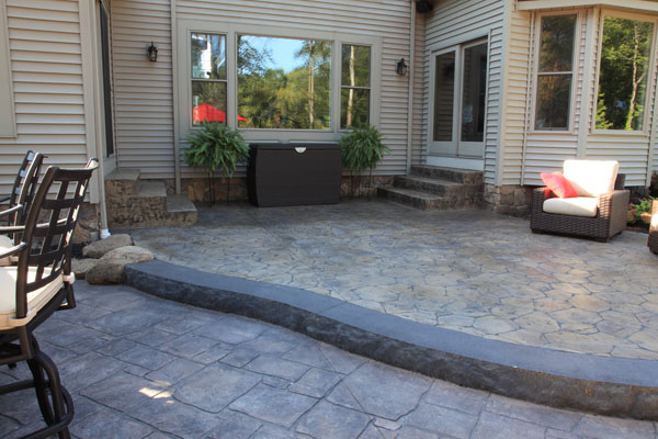 face stamped patio with patios concrete tiered backyard stairs rock step
