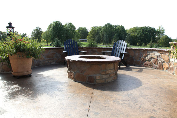 Round Wood Burning Firepit with Stone Wall Seating