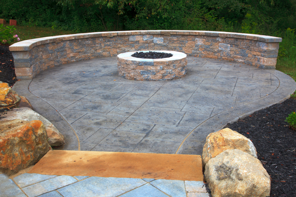 Techo-Bloc Firepit with Matching Seatwall on Concrete Patio