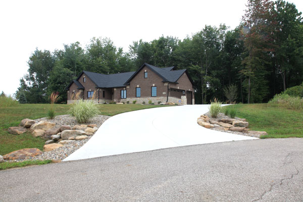 New Home Construction Driveway with Landscaped Culvert