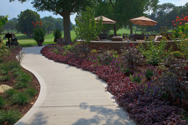 Concrete Walkway with Decorative Landscaping