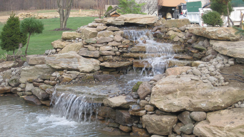 B t klein s landscaping solution center before after for How to build a coy pond with waterfall