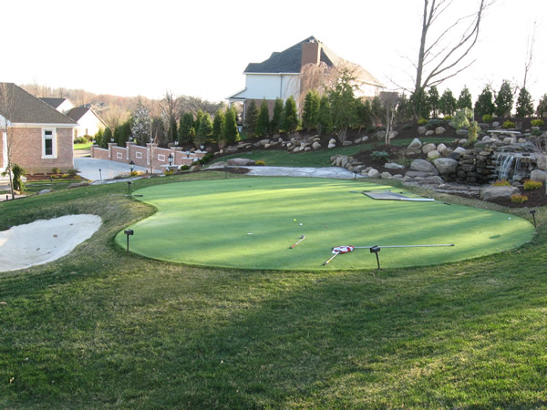 Putting Green With Pondless Water Feature And Sandtrap