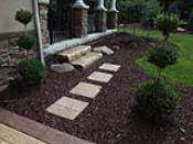 Concrete Stepping Stone Through Mulch Bed