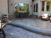 Tiered Stamped Concrete Patios with Rock Face Step
