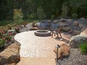 Firepit Patio in Hillside with Large Rock Croppings