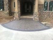 Stamped Entry Way with Stone Pillars