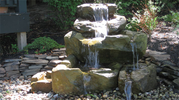 Klein 39 s lawn landscaping water features hand carved natural stone fountains - How to build an outdoor fountain with rocks ...