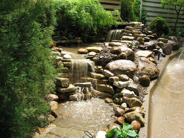 B t klein s landscaping water features pond waterfalls for Pond waterfall images