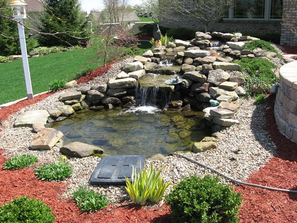 Image gallery patio waterfalls for Pond water features waterfalls