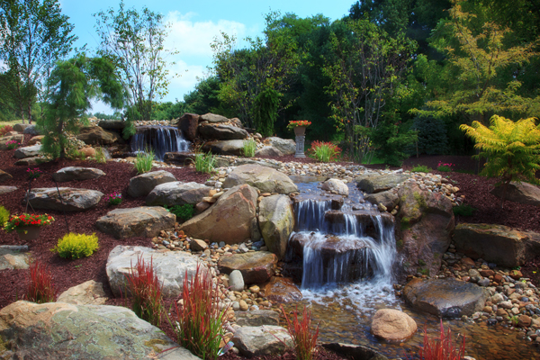 Pondless Waterfall with Colorful Landsaping